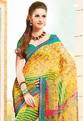 The most radiant carnival of style and beauty. This beautiful yellow super net saree is nicely designed with floral, abstract, leaf like print and graceful patch border. Beautiful print work on saree make attractive to impress all. It will enhance your personality and gives you a singular look. Contrasting green blouse is available with this saree. Slight color variations are due to differing screen and photography resolution.
