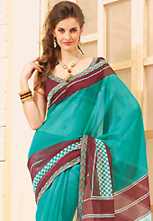 An endearing splash oh colors look gorgeous tridimensional charm. This beautiful turquoise and maroon super net saree is nicely designed with abstract, check print and graceful patch border. Beautiful print work on saree make attractive to impress all. It will enhance your personality and gives you a singular look. Matching blouse is available with this saree. Slight color variations are due to differing screen and photography resolution.