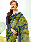 The traditional patterns used on this saree maintain the ethnic look. This beautiful olive green and dark blue super net saree is nicely designed with stripe, dots, polka dots print and graceful patch border. Beautiful print work on saree make attractive to impress all. It will enhance your personality and gives you a singular look. Matching blouse is available with this saree. Slight color variations are due to differing screen and photography resolution.