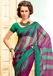 Keep the interest with this printed saree. This beautiful dark magenta and green super net saree is nicely designed with stripe, dots, polka dots print and graceful patch border. Beautiful print work on saree make attractive to impress all. It will enhance your personality and gives you a singular look. Matching blouse is available with this saree. Slight color variations are due to differing screen and photography resolution.