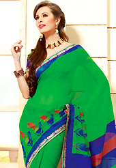 Style and trend will be at the peak of your beauty when you adorn this saree. This beautiful green and blue super net saree is nicely designed with paisley print and graceful patch border. Beautiful print work on saree make attractive to impress all. It will enhance your personality and gives you a singular look. Matching blouse is available with this saree. Slight color variations are due to differing screen and photography resolution.