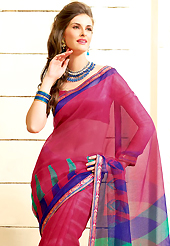 Welcome to the new era of Indian fashion wear. This beautiful dark pink and blue super net saree is nicely designed with paisley print and graceful patch border. Beautiful print work on saree make attractive to impress all. It will enhance your personality and gives you a singular look. Matching blouse is available with this saree. Slight color variations are due to differing screen and photography resolution.