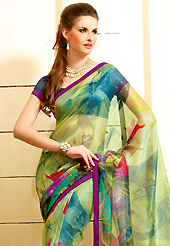 Printed sarees are the best choice for a girl to enhance her feminine look. This beautiful green super net saree is nicely designed with floral, abstract print and graceful patch border. Beautiful print work on saree make attractive to impress all. It will enhance your personality and gives you a singular look. Contrasting dark blue blouse is available with this saree. Slight color variations are due to differing screen and photography resolution.