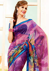 It is color this season and bright shaded suits are really something that is totally in vogue. This beautiful magenta super net saree is nicely designed with floral, abstract print and graceful patch border. Beautiful print work on saree make attractive to impress all. It will enhance your personality and gives you a singular look. Contrasting dark blue blouse is available with this saree. Slight color variations are due to differing screen and photography resolution.