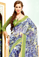 A desire that evokes a sense of belonging with a striking details. This beautiful blue and light olive green super net saree is nicely designed with floral print work. Beautiful print work on saree make attractive to impress all. It will enhance your personality and gives you a singular look.Matching blouse is available with this saree. Slight color variations are due to differing screen and photography resolution.