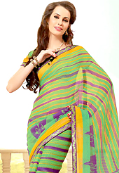 Make a trendy look with this classic printed saree. This beautiful green and purple super net saree is nicely designed with floral, stripe print and graceful patch border. Beautiful print work on saree make attractive to impress all. It will enhance your personality and gives you a singular look. Matching blouse is available with this saree. Slight color variations are due to differing screen and photography resolution.