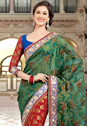 Style and trend will be at the peak of your beauty when you adorn this saree. This dark green and red dupion and viscose saree have beautiful embroidery patch work which is embellished with resham and zari work. Fabulous designed embroidery gives you an ethnic look and increasing your beauty. Contrasting blue and red blouse is available. Slight Color variations are possible due to differing screen and photograph resolutions.
