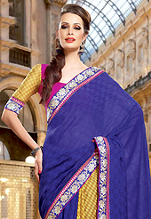 Let your personality articulate for you with this amazing embroidered saree. This dark blue and yellow dupion jacquard saree have beautiful embroidery patch work which is embellished with resham and zari work. Fabulous designed embroidery gives you an ethnic look and increasing your beauty. Contrasting pink and yellow blouse is available. Slight Color variations are possible due to differing screen and photograph resolutions.