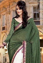 A desire that evokes a sense of belonging with a striking details. This dark green and off white art silk saree have beautiful embroidery patch work which is embellished with resham and zari work. Fabulous designed embroidery gives you an ethnic look and increasing your beauty. Matching blouse is available. Slight Color variations are possible due to differing screen and photograph resolutions.