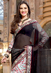 Dreamy variation on shape and forms compliment your style with tradition. This black and off white faux georgette saree have beautiful embroidery patch work which is embellished with resham and zari work. Fabulous designed embroidery gives you an ethnic look and increasing your beauty. Matching blouse is available. Slight Color variations are possible due to differing screen and photograph resolutions.