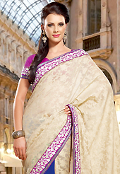 Take a look on the changing fashion of the season. This cream and blue dupion and faux georgette saree have beautiful embroidery patch work which is embellished with resham work. Fabulous designed embroidery gives you an ethnic look and increasing your beauty. Contrasting magenta blouse is available. Slight Color variations are possible due to differing screen and photograph resolutions.