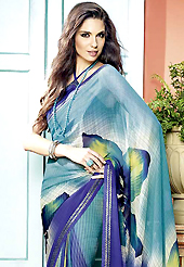 Exquisite combination of color, fabric can be seen here. This beautiful light blue and purple faux georgette saree is nicely designed with flower, stripe print and graceful patch border. Beautiful print work on saree make attractive to impress all. It will enhance your personality and gives you a singular look. Matching blouse is available with this saree. Slight color variations are due to differing screen and photography resolution.