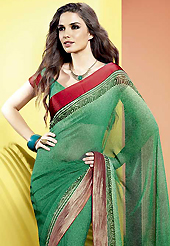 Get ready to sizzle all around you by sparkling saree. This beautiful green faux georgette saree is nicely designed with abstract print and graceful patch border. Beautiful print work on saree make attractive to impress all. It will enhance your personality and gives you a singular look. Matching blouse is available with this saree. Slight color variations are due to differing screen and photography resolution.
