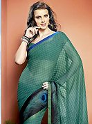 The traditional patterns used on this saree maintain the ethnic look. This beautiful turquoise green and black faux georgette saree is nicely designed with abstract, peacock feather like print and graceful patch border. Beautiful print work on saree make attractive to impress all. It will enhance your personality and gives you a singular look. Matching blouse is available with this saree. Slight color variations are due to differing screen and photography resolution.