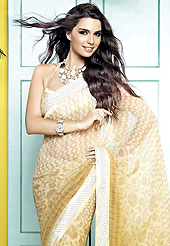 You can be sure that ethnic fashions selections of clothing are taken from the latest trend in today's fashion. This beautiful cream and shaded yellow faux georgette saree is nicely designed with floral, abstract print and graceful patch border. Beautiful print work on saree make attractive to impress all. It will enhance your personality and gives you a singular look. Matching blouse is available with this saree. Slight color variations are due to differing screen and photography resolution.
