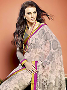 Dreamy variation on shape and forms compliment your style with tradition. This beautiful off white faux georgette saree is nicely designed with floral print and graceful patch border. Beautiful print work on saree make attractive to impress all. It will enhance your personality and gives you a singular look. Contrasting grey blouse is available with this saree. Slight color variations are due to differing screen and photography resolution.