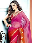Try out this year top trend, glowing, bold and natural collection. This beautiful shaded magenta and rust faux georgette saree is nicely designed with abstract, stripe print and graceful patch border. Beautiful print work on saree make attractive to impress all. It will enhance your personality and gives you a singular look. Matching blouse is available with this saree. Slight color variations are due to differing screen and photography resolution.