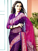 An occasion wear perfect is ready to rock you. This beautiful shaded purple and pink faux georgette saree is nicely designed with bandhej, floral print and graceful patch border. Beautiful print work on saree make attractive to impress all. It will enhance your personality and gives you a singular look. Matching blouse is available with this saree. Slight color variations are due to differing screen and photography resolution.
