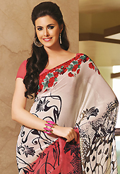 Keep the interest with this printed saree. This beautiful off white and red faux georgette saree is nicely designed with floral and abstract print work. Beautiful print work on saree make attractive to impress all. It will enhance your personality and gives you a singular look. Matching blouse is available with this saree. Slight color variations are due to differing screen and photography resolution.