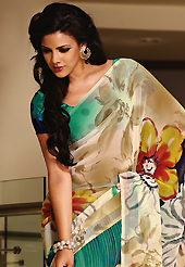 An endearing splash oh colors look gorgeous tridimensional charm. This beautiful cream and green faux georgette saree is nicely designed with flower and abstract print work. Beautiful print work on saree make attractive to impress all. It will enhance your personality and gives you a singular look. Matching blouse is available with this saree. Slight color variations are due to differing screen and photography resolution.