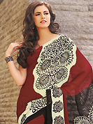 Exquisite combination of color, fabric can be seen here. This beautiful dark red, cream and black faux georgette saree is nicely designed with abstract print work. Beautiful print work on saree make attractive to impress all. It will enhance your personality and gives you a singular look. Matching blouse is available with this saree. Slight color variations are due to differing screen and photography resolution.