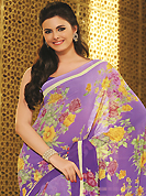Envelope yourself in classic look with this charming saree. This beautiful light purple faux georgette saree is nicely designed with floral print work. Beautiful print work on saree make attractive to impress all. It will enhance your personality and gives you a singular look. Matching blouse is available with this saree. Slight color variations are due to differing screen and photography resolution.