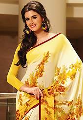 Try out this year top trend, glowing, bold and natural collection. This beautiful shaded cream and yellow faux georgette saree is nicely designed with floral and stripe print work. Beautiful print work on saree make attractive to impress all. It will enhance your personality and gives you a singular look. Matching blouse is available with this saree. Slight color variations are due to differing screen and photography resolution.