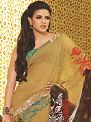 It is color this season and bright shaded suits are really something that is totally in vogue. This beautiful fawn faux georgette saree is nicely designed with abstract and paisley print work. Beautiful print work on saree make attractive to impress all. It will enhance your personality and gives you a singular look. Matching blouse is available with this saree. Slight color variations are due to differing screen and photography resolution.