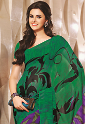 Style and trend will be at the peak of your beauty when you adorn this saree. This beautiful green and purple faux georgette saree is nicely designed with abstract print work. Beautiful print work on saree make attractive to impress all. It will enhance your personality and gives you a singular look. Matching blouse is available with this saree. Slight color variations are due to differing screen and photography resolution.