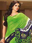 Get ready to sizzle all around you by sparkling sareen. This beautiful green and navy blue faux georgette saree is nicely designed with floral and abstract print work. Beautiful print work on saree make attractive to impress all. It will enhance your personality and gives you a singular look. Matching blouse is available with this saree. Slight color variations are due to differing screen and photography resolution.