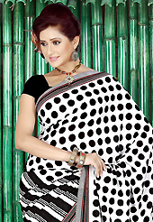 Era with extension in fashion, style, Grace and elegance have developed grand love affair with this ethnical wear. This beautiful white and black faux crepe saree is nicely designed with geometric print work. Beautiful print work on saree make attractive to impress all. Matching black blouse is available with this saree. Slight color variations are due to differing screen and photography resolution.