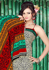 Keep the interest with this printed saree. This beautiful cream and green faux crepe saree is nicely designed with abstract print work. Beautiful print work on saree make attractive to impress all. Contrasting red blouse is available with this saree. Slight color variations are due to differing screen and photography resolution.