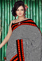 The most radiant carnival of style and beauty. This beautiful white, black and orange faux crepe saree is nicely designed with abstract print work. Beautiful print work on saree make attractive to impress all. Matching black blouse is available with this saree. Slight color variations are due to differing screen and photography resolution.