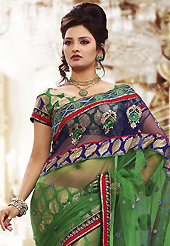 An casual wear perfect is ready to rock you. This green and blue net and viscose saree is nicely designed with embroidered patch work is done with resham, zari and stone work. Beautiful embroidery work on saree make attractive to impress all. This saree gives you a modern and different look in fabulous style. Matching blouse is available. Slight color variations are possible due to differing screen and photograph resolution.