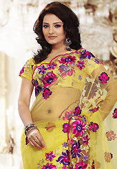 Elegance and innovation of designs crafted for you. This yellow net saree is nicely designed with embroidered patch work is done with resham and stone work. Beautiful embroidery work on saree make attractive to impress all. This saree gives you a modern and different look in fabulous style. Matching blouse is available. Slight color variations are possible due to differing screen and photograph resolution.