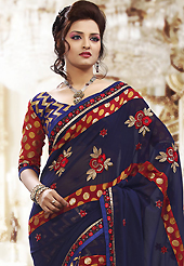 Exquisite combination of color, fabric can be seen here. This navy blue and maroon georgette, brasso net saree is nicely designed with embroidered patch work is done with resham, zari, sequins and stone work. Beautiful embroidery work on saree make attractive to impress all. This saree gives you a modern and different look in fabulous style. Matching blouse is available. Slight color variations are possible due to differing screen and photograph resolution.