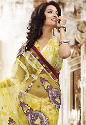 The most beautiful refinements for style and tradition. This yellow net and brasso saree is nicely designed with embroidered patch work is done with resham, zari, sequins and stone work. Beautiful embroidery work on saree make attractive to impress all. This saree gives you a modern and different look in fabulous style. Matching blouse is available. Slight color variations are possible due to differing screen and photograph resolution.