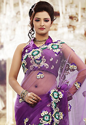 Get ready to sizzle all around you by sparkling saree. This shaded purle net saree is nicely designed with embroidered patch work is done with resham and stone work. Beautiful embroidery work on saree make attractive to impress all. This saree gives you a modern and different look in fabulous style. Matching blouse is available. Slight color variations are possible due to differing screen and photograph resolution.