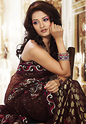 The traditional patterns used on this saree maintain the ethnic look. This dark chocolate brown net and viscose saree is nicely designed with embroidered patch work is done with resham, zari and sequins work. Beautiful embroidery work on saree make attractive to impress all. This saree gives you a modern and different look in fabulous style. Matching blouse is available. Slight color variations are possible due to differing screen and photograph resolution.