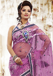 An occasion wear perfect is ready to rock you. This onion pink net and brasso saree is nicely designed with embroidered patch work is done with resham, zari and sequins work. Beautiful embroidery work on saree make attractive to impress all. This saree gives you a modern and different look in fabulous style. Matching blouse is available. Slight color variations are possible due to differing screen and photograph resolution.