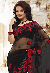 Ultimate collection of embroidery sarees with fabulous style. This black net saree is nicely designed with embroidered patch work is done with resham and sequins work. Beautiful embroidery work on saree make attractive to impress all. This saree gives you a modern and different look in fabulous style. Matching blouse is available. Slight color variations are possible due to differing screen and photograph resolution.