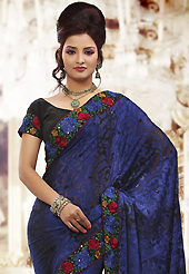 Welcome to the new era of Indian fashion wear. This dark blue brasso saree is nicely designed with embroidered patch work is done with resham and sequins work. Beautiful embroidery work on saree make attractive to impress all. This saree gives you a modern and different look in fabulous style. Contrasting black blouse is available. Slight color variations are possible due to differing screen and photograph resolution.
