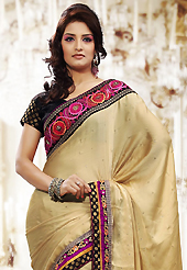 Take a look on the changing fashion of the season. This light fawn chiffon saree is nicely designed with embroidered patch work is done with resham, zari, stone and lace work. Beautiful embroidery work on saree make attractive to impress all. This saree gives you a modern and different look in fabulous style. Contrasting black blouse is available. Slight color variations are possible due to differing screen and photograph resolution.
