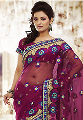 Dreamy variation on shape and forms compliment your style with tradition. This burgundy net saree is nicely designed with embroidered patch work is done with resham, zari and stone work. Beautiful embroidery work on saree make attractive to impress all. This saree gives you a modern and different look in fabulous style. Matching blouse is available. Slight color variations are possible due to differing screen and photograph resolution.