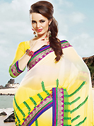 An endearing splash oh colors look gorgeous tridimensional charm. This shaded cream, yellow and green chiffon saree is nicely designed with embroidered patch work is done with resham and zari work. Beautiful embroidery work on saree make attractive to impress all. This saree gives you a modern and different look in fabulous style. Matching blouse is available. Slight color variations are possible due to differing screen and photograph resolution.