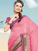 Make a trendy look with this classic embroidered saree. This maroon and green net and art silk saree is nicely designed with embroidered patch work is done with resham and zari work. Beautiful embroidery work on saree make attractive to impress all. This saree gives you a modern and different look in fabulous style. Matching green blouse is available. Slight color variations are possible due to differing screen and photograph resolution.