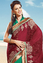Keep the interest with this designer embroidery saree. This cream jacquard saree is nicely designed with embroidered patch work is done with zari work. Beautiful embroidery work on saree make attractive to impress all. This saree gives you a modern and different look in fabulous style. Contrasting magenta blouse is available. Slight color variations are possible due to differing screen and photograph resolution.