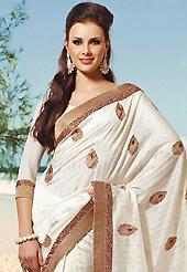 Take the fashion industry by storm in this beautiful embroidered saree. This black and maroon art silk and brocade saree is nicely designed with embroidered patch work is done with resham, zari and lace work. Beautiful embroidery work on saree make attractive to impress all. This saree gives you a modern and different look in fabulous style. Matching blouse is available. Slight color variations are possible due to differing screen and photograph resolution.