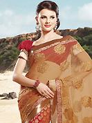 Embroidered sarees are the best choice for a girl to enhance her feminine look. This light brown and dark red net and brocade saree is nicely designed with embroidered patch work is done with resham, zari and stone work. Beautiful embroidery work on saree make attractive to impress all. This saree gives you a modern and different look in fabulous style. Matching blouse is available. Slight color variations are possible due to differing screen and photograph resolution.