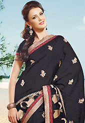 Attract all attentions with this embroidered saree. This black art silk saree is nicely designed with embroidered patch work is done with resham, zari and lace work. Beautiful embroidery work on saree make attractive to impress all. This saree gives you a modern and different look in fabulous style. Matching blouse is available. Slight color variations are possible due to differing screen and photograph resolution.